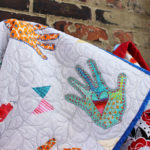 """""""Helping Hands"""" QuiltCon Charity Quilts"""